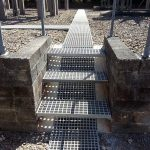 Moulded GRP grating for trench access