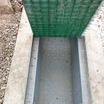 Moulded square mesh GRP grating in a Composite Cable Trench