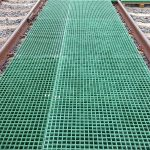 Moulded GRP square mesh grating in a composite Cable Trench